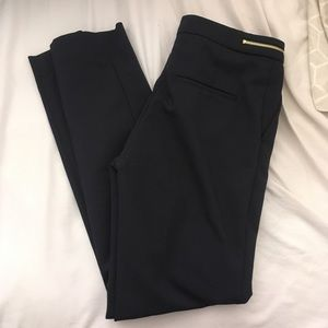 Pants with faux gold zip detail at waist